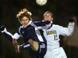 Arapahoe High School's Connor Talbert (#17, Mid) goes up for a loose ball with Heritage High...