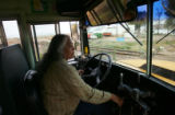 School bus driver Dee Esparza-Ecsobar (cq) prepares to cross the railroad tracks about a half-mile...