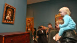 Jim Peters (cq), right, and his three year old daughter, Mariel Peters, get a look at the painting...