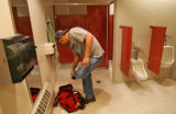 Danny Sprague, a 23-year-old senior at the Colorado School of Mines, changes cloths in a bathroom...