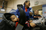 (BG966) Gabriel Nunez, 14mo., {from great grandparent}, is carried by his great-grandfather Al...