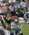 (BG821) Denver Broncos Mike Bell is pulled down by Indianapolis Colts Nick Harper in the third...