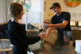 Christina Eide, cq, accepts her smoothie from Squeeze employee Dan Neiswender, cq, Wednesday Oct....