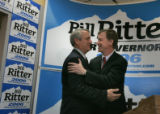 Mayor John Hickenlooper embraces gubernatorial candidate Bill Ritter after announcing his support...