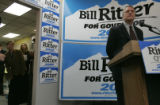 Jeannie Ritter peaks around the door as her husband gubernatorial candidate Bill Ritter talks to...