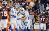 (MAP888)The Denver Broncos Nick Ferguson (#25, S) and Darrent Williams (#27, CB) react as...