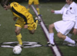 Faith Christian's #10-Sterling Copeland fights for control of the ball against Colorado Academy...