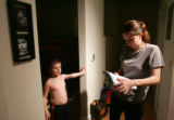 Mother Jenni Springer (cq), right helps her son  James Donald Springer (cq), 6, left, with his...