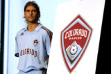 (DLM4958) -  Colorado Rapids forward Nicolas Hernandez dons a new away uniform while standing next...