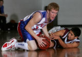 Silver State's #14, Caleb Mays, left, fights after the ball against Community Christian's #5 Vince...