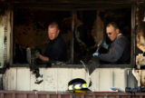 (DLM0314) -  South Adams County Fire District investigator Andy Nevil, left, and Don Peak with...
