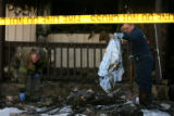 (DLM0721) -  South Adams County Fire District investigators Andy Nevil, left, and Kevin Vincel,...