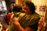 (DLM5309) -  Melissa Rodarte weeps as she gets a hug from Obdulia Avalos, who was the god-parent...