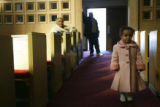 (DLM1176) -  Mikaella Tawedrose, 2, stands in the aisle as her grandmother Alemnesh Guangul, 74,...