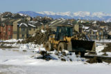 A front end loader begins breaking ground for new roads near the Lone Tree Recreation Center in...