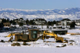 A road grader begins breaking ground for new roads near the Lone Tree Recreation Center in Lone...