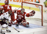 MAEA107 - Boston University goaltender John Curry (36) stretches but cannot stop a shot for the...