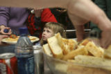 Ella Rupp,4, (from mom), waits for spaghetti as everybody around her seems to be getting their...