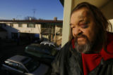 (DLM1249) -  Rich Ackelson stands on the balcony outside his room at the Mesa Motel in Lakewood,...
