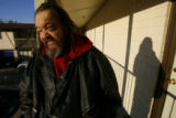 (DLM1252) -  Rich Ackelson stands on the balcony outside his room at the Mesa Motel in Lakewood,...