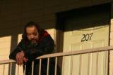 (DLM1283) -  Rich Ackelson stands on the balcony outside his room at the Mesa Motel in Lakewood,...