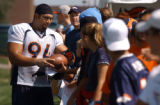 (DOVE VALLEY, Co., SHOT 7/28/2004) Denver Broncos defensive tackle Luther Elliss (#94) signs a...
