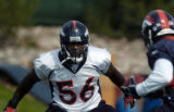 (DOVE VALLEY, Co., SHOT 7/28/2004) Denver Broncos' linebacker Al Wilson (#56) closes in on...