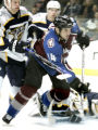 Avs #14 Ian Laperriere takes a high stick from Jason Arnot  during the 3rd period as the Avalanche...