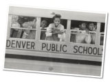 Students of Denver Public Schools arrive on a bus at Merrill Middle School, 1551 South Monroe...