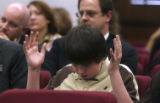 Ryan Davis, (cq) 12 of Colo. Springs prays during the hearing for SB07-138 sponsored by Senator...
