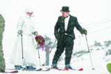 Karyn Krout, cq, and her new husband Tucker Brown cq, prepare to take their first ski run together...