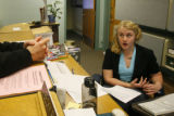 (DLM1818) -  Emilie Johnson, 21, talks to another student while working  behind the front desk of...
