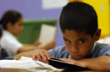 (DENVER, CO., JULY 29, 2004)  Fifth grader at Barrrett Elementary  Ernesto Delgado looks away from...