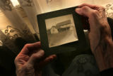 MJM283   Margaret Lamb holds a photo of a turn of the century house that stood on her family ranch...