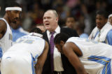 DXA113 - Denver Nuggets head coach George Karl (facing camera), center,  confers with, from left,...