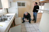 Phil Heter (cq) left, and his son Adam Heter (cq) inspect and photograph a foreclosed home at 1725...