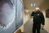Lead scientist Peter Smith looks at a photo of Mars with 3-D glasses after a press conference at...