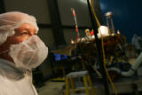 Program Manager Ed Sedivy stands next to the Phoenix Mars Lander at Lockheed Martin Space Systems...
