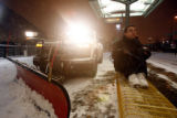 (DLM2414) -  A snow plow clears the RTD train station at the Auraria Campus on Colfax Avenue as...