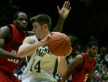 Colorado State center Jason Smith is guarded by UNLV's Joel Anthony, left, and Wendell White,...
