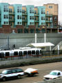 Northbound I-25 traffic passes the Louisiana /Pearl Light Rail Station, Friday Feb. 16 ,2007 as...