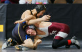 Soroco's Levi Gonzales (right in red) wrestles Dolores Huerta's Stephen Aragon (left in black)...