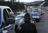 MJM244  Colorado State Patrol officer, Clare Faulkner (cq)advises a motorist and their dog that...