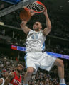 Denver Nuggets forward Linas Kleiza dunks in two of his first half points as Portland's LaMarcus...