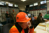 MJM411  Tunnel maintenance worker, Tom Rowan  (cq) answers a phone as he monitors traffic on...