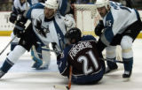 (DENVER, CO - 4/26/04) -- Colorado Avalanche forward Peter Forsberg, #21, holds San Jose Sharks...