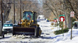 A front-end loader breaks up ice along 10th Avenue near Garfield Street on Monday February 5,...