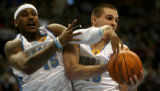 Denver Nuggets Carmelo Anthony, #15 and Linas Kleiza, #43 battle for a rebound as they and  host...