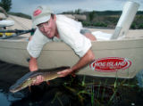 John St. John, shown here with a Yampa River northern pike, will be one of the keynote speakers at...