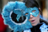 Jaime Aragon (cq), 29, of Dillon wears a mask for the Mardi Gras celebration at Keystone, Colo.,...